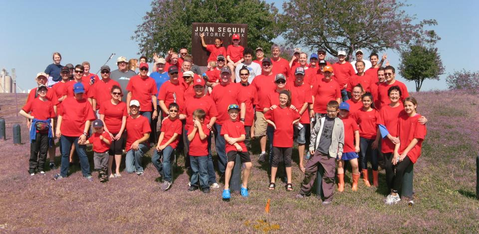 TotalEnergies volunteers and their families participate in the annual Trash Bash event (cover photo)